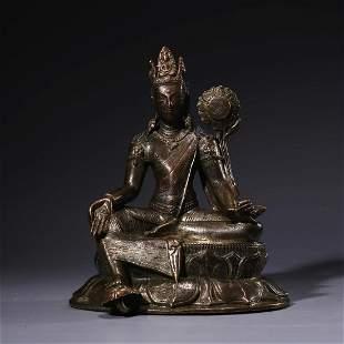 A Bronze Statue Of Green Tara
