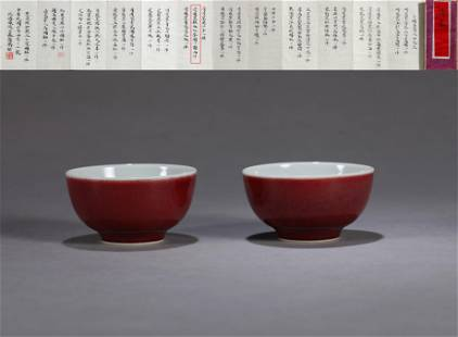 A PAIR OF RED-GLAZED ROUND BOWLS
