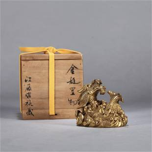 A CHINESE GILT BRONZE FISH SHAPED PAPER WEIGHT