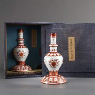 A PAIR OF CHINESE IRON RED GLAZED VASES WITH FLOWER