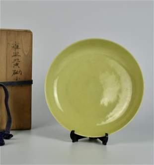 A CHINESE YELLOW-GLAZED DISH