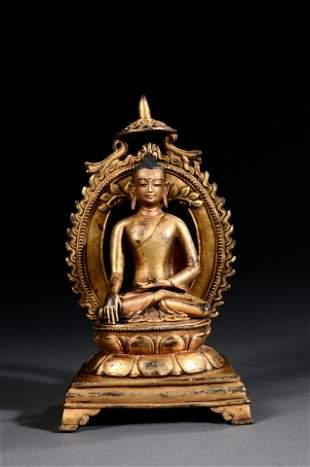 A INDIAN PALA PERIOD GILT BRONZE FIGURE OF BUDDHA