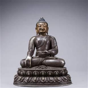 A Chinese Silver Sakyamuni Statue