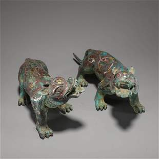 A Pair of Chinese Gold and Silver Inlaid Bronze Beasts