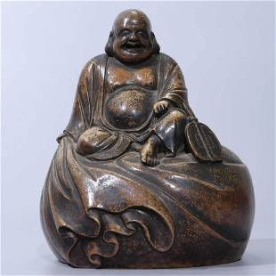 A POTTERY FIGURINE OF MONK