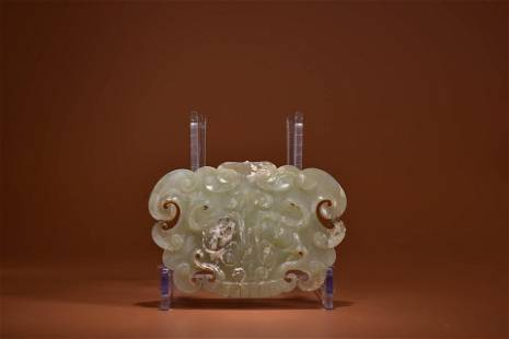A CARVED JADE BEAST-FACE ORNAMENT