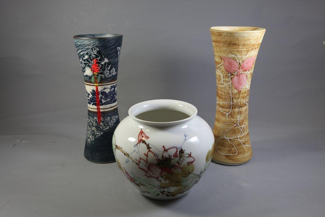12: A group of three Porcelain Flower Vases
