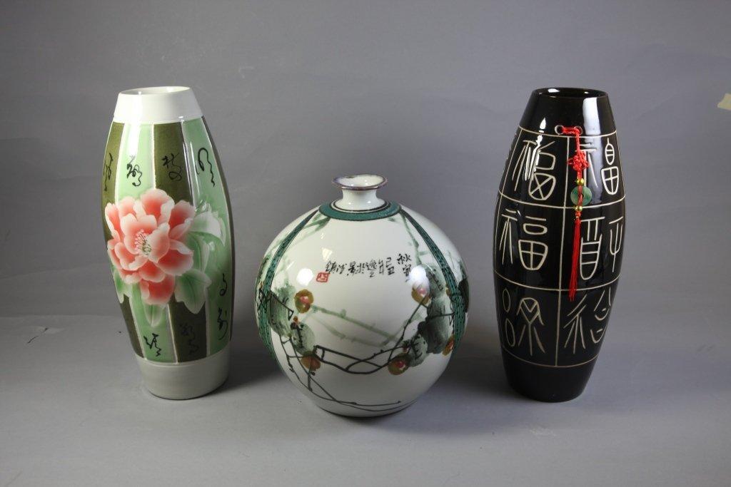 14: A group of three Porcelain Flower Vases