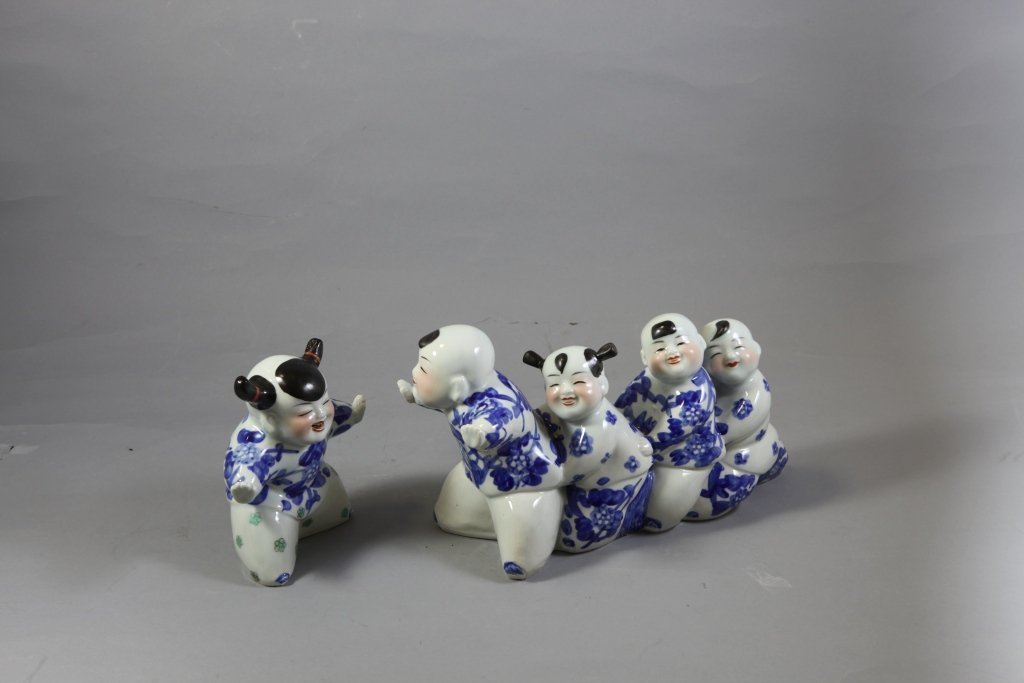 17: Blue and White Sculpture with Children Playing