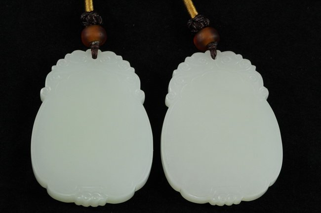 315: Finely carved nephrite white jade plaque pair