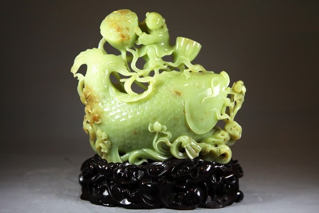 425: Exquisitely Carved Jadeite Child playing with lotu