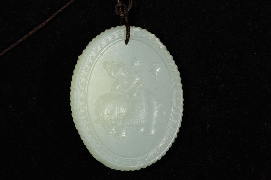 A Chinese White Jade Pendant