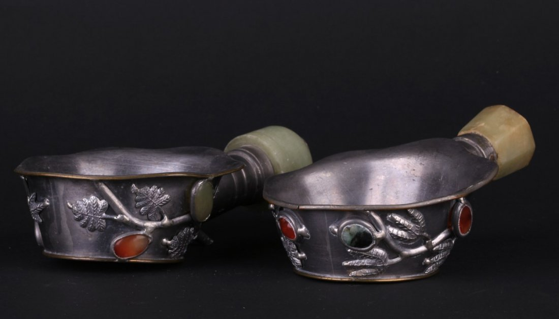 Antique Chinese metal work cup with flowing leaf and
