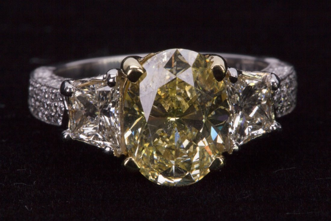 3.14 carat Fancy Yellow Diamond Ring with GIA Cert