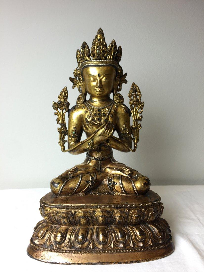 A GILT BUDDHA STATUE