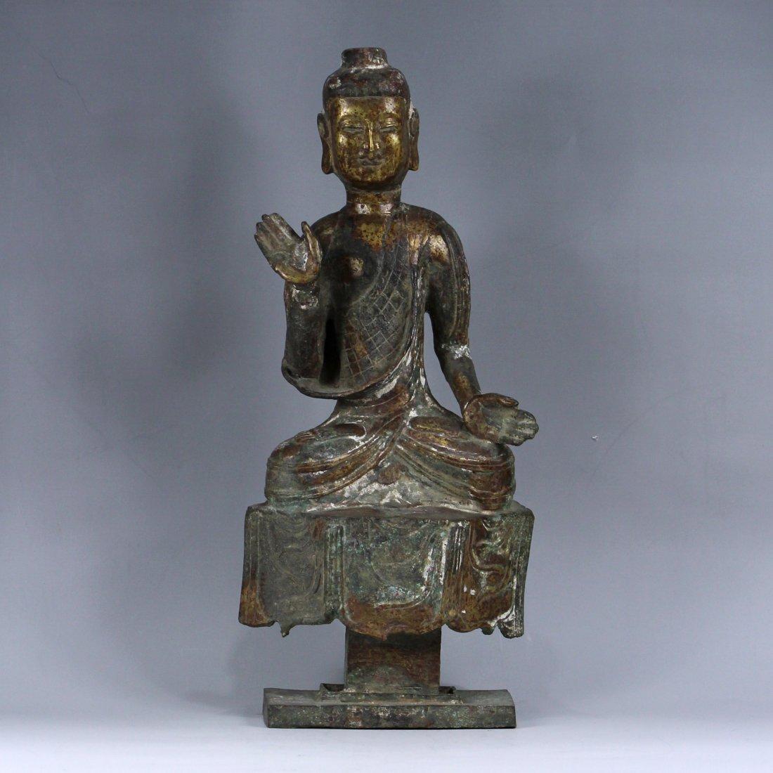 A BRONZE SCULPTURE OF BUDDHA