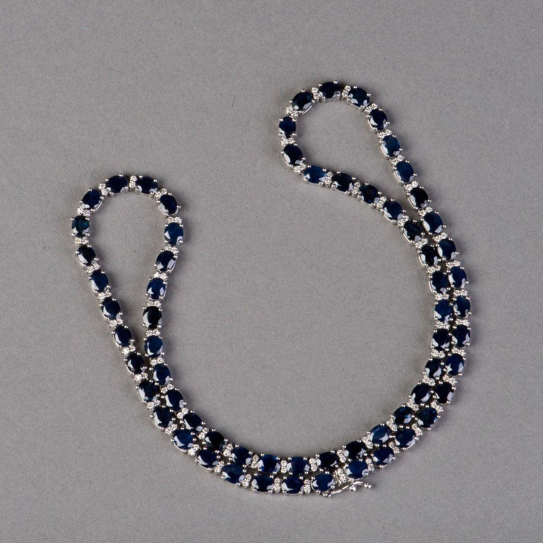 AN OVAL-CUT SAPPHIRE NECKLACE