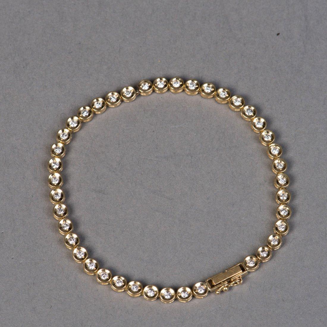 A GOLD BRACELET WITH DIAMOND SETTING