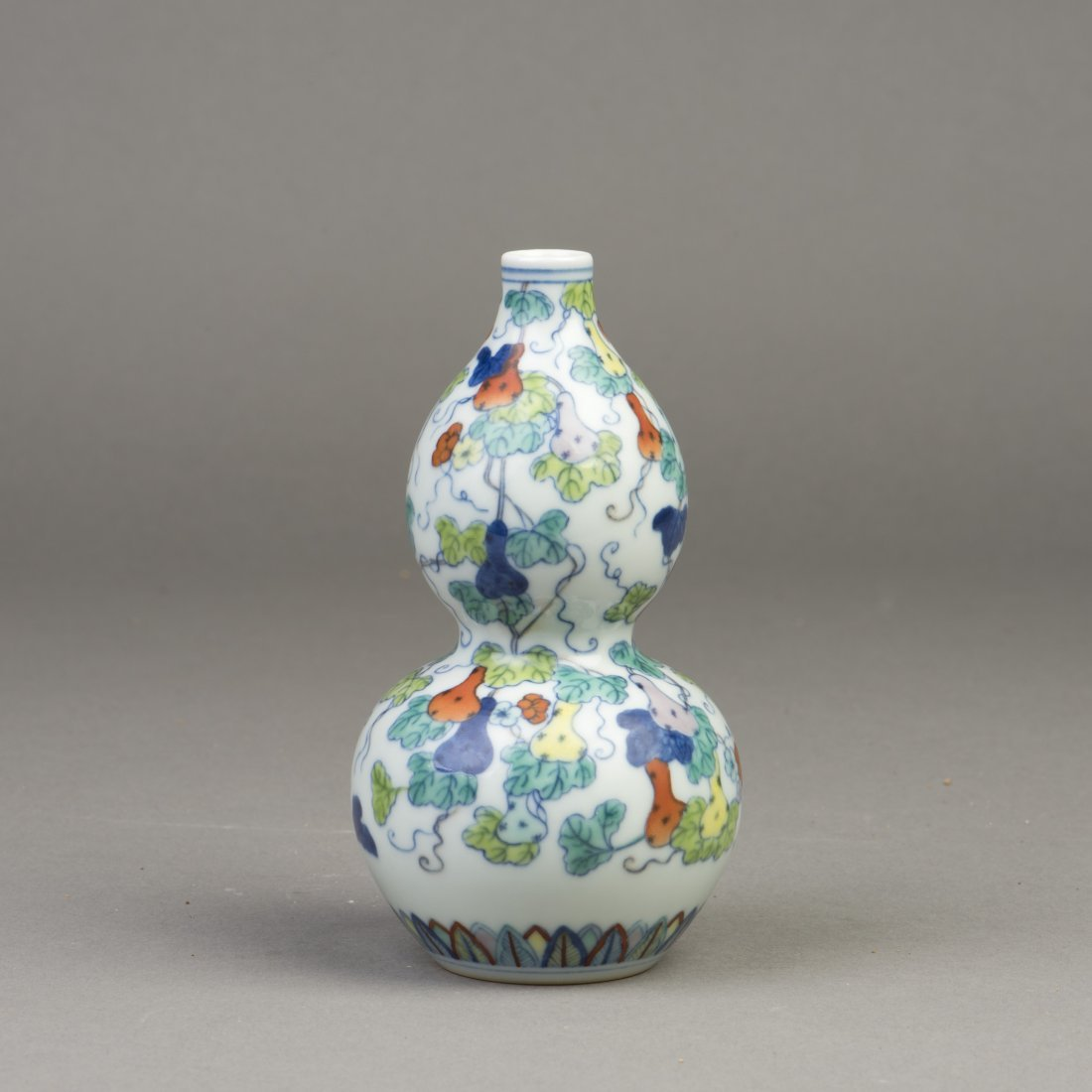 A CHINESE GOURD-SHAPED DOUCAI PORCELAIN VASE