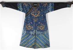 A CHINESE BLUE SILK EMBROIDERED DRAGON ROBE