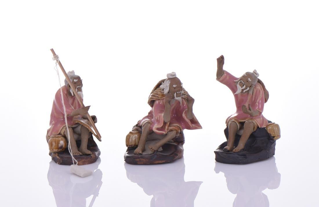 Three Chinese Mud Men Glazed Figures of Fishermen.