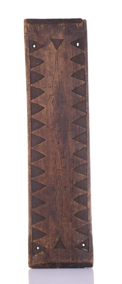 African Wood Carved Wall Plaque With Tooth Design.