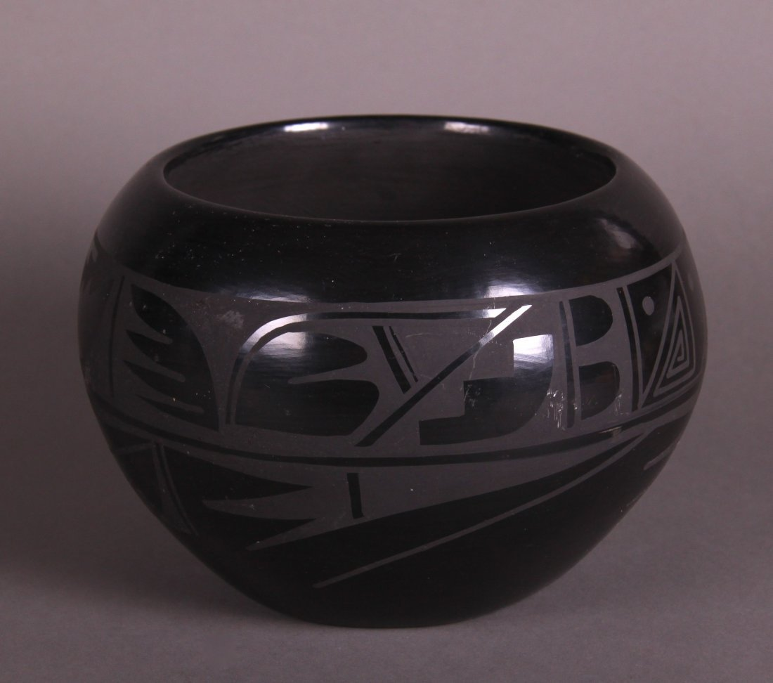 Carmelita Dunlap Medium Black on Black Pottery, signed.