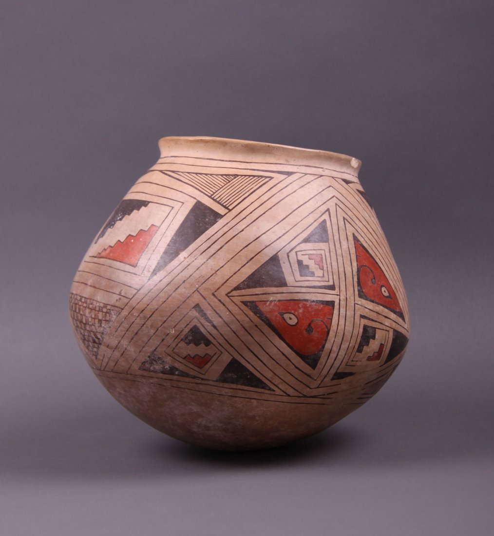 Southwest Polychrome Pot.  Condition Report: small chip