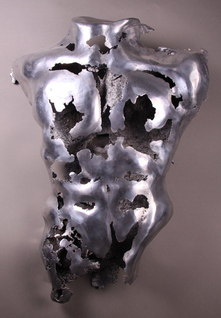 Torso metal sculpture. Signed by artist.  Size: 24