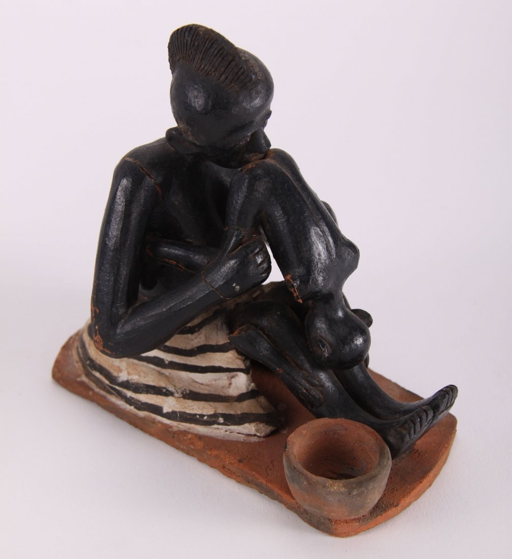Two (2) African erotic ceramic sculptures (unknown - 9