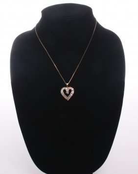 Sterling Silver Heart Shaped Pendant With Cz Baguette D