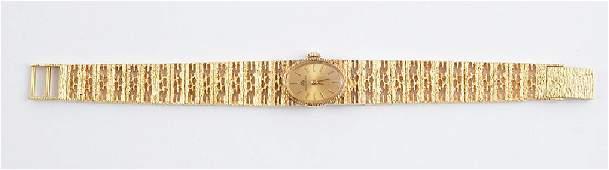 BUCHERER  18K GOLD