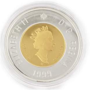 Une monnaie en or du Canada /  One $50 Canadian Gold