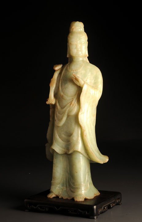 9: AN ANTIQUE LARGE CARVING OF A STANDING GUAN YIN CHIN