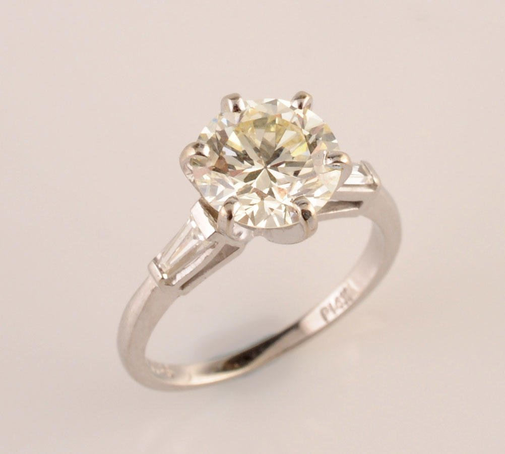 2001: 14K white gold solitaire ring set with one 2.50ct