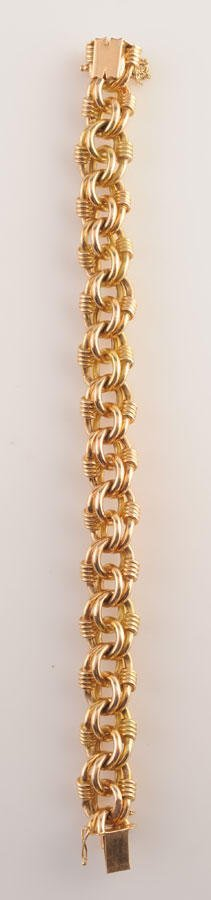 2002: 18K yellow gold (stamped) interlaced mesh articul