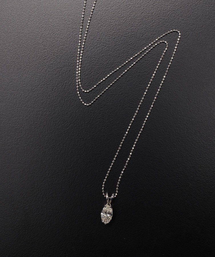 2007B: 14K white gold pendant set with an approximately