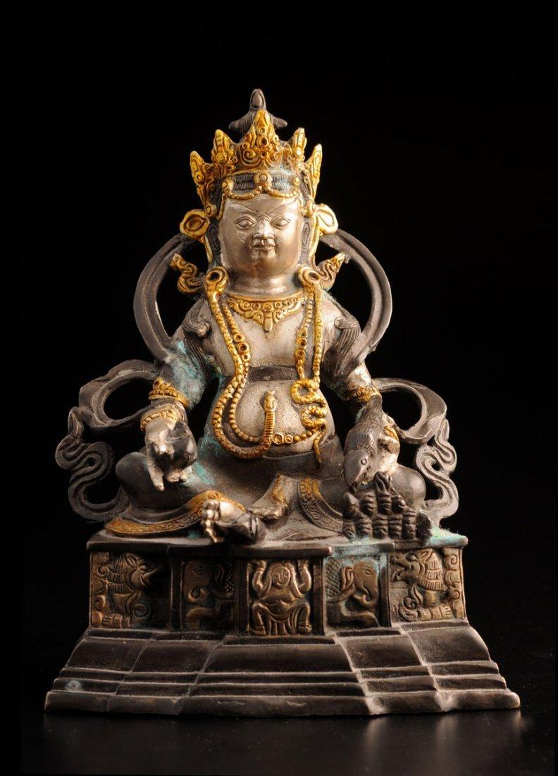 A PARTLY-GILT BRONZE FIGURE OF A SEATED BUDDHA CHINA, S
