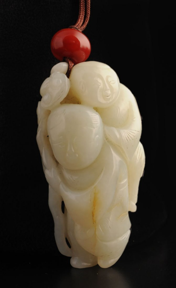 CARVED JADE GROUP FIGURE OF TWO CHARACTERS WITH A GNARL