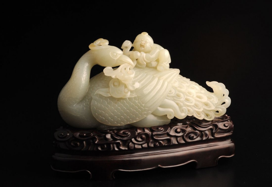 CARVED JADE GROUP FIGURE OF A BOY RIDDING A PEACOCK CHI