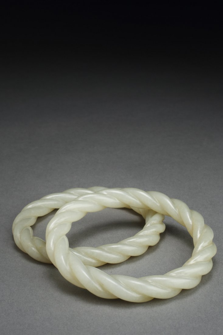 ANTIQUE PAIR OF TWISTED JADE BRACELETS