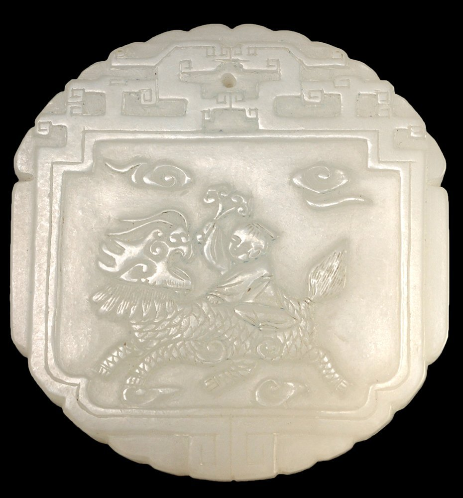 WHITE JADE PLAQUE PENDANT ADORNED WITH A SMALL BOY RIDI
