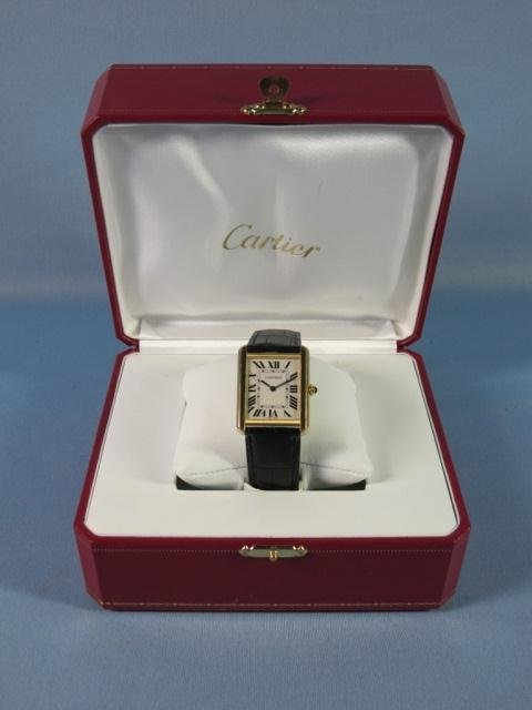 57: 18K Y.G. Cartier Tank Men's Watch with Box