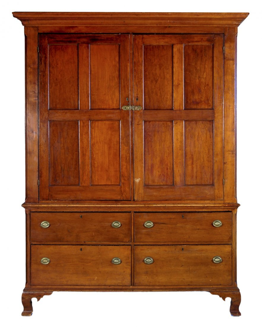 24: Cherry Chippendale linen press