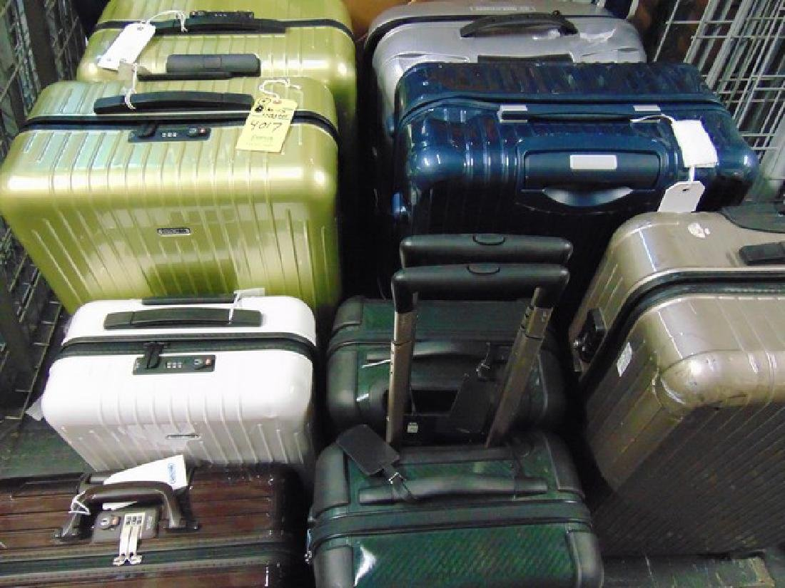 9 ASSORTED PIECES DAMAGED LUGGAGE- RIMOWA / TUMI /