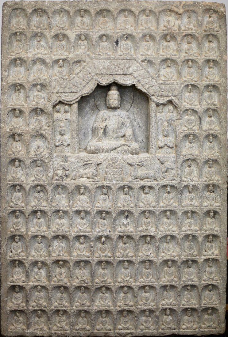 146: STONE MONUMENT WITH BUDHA STATUES