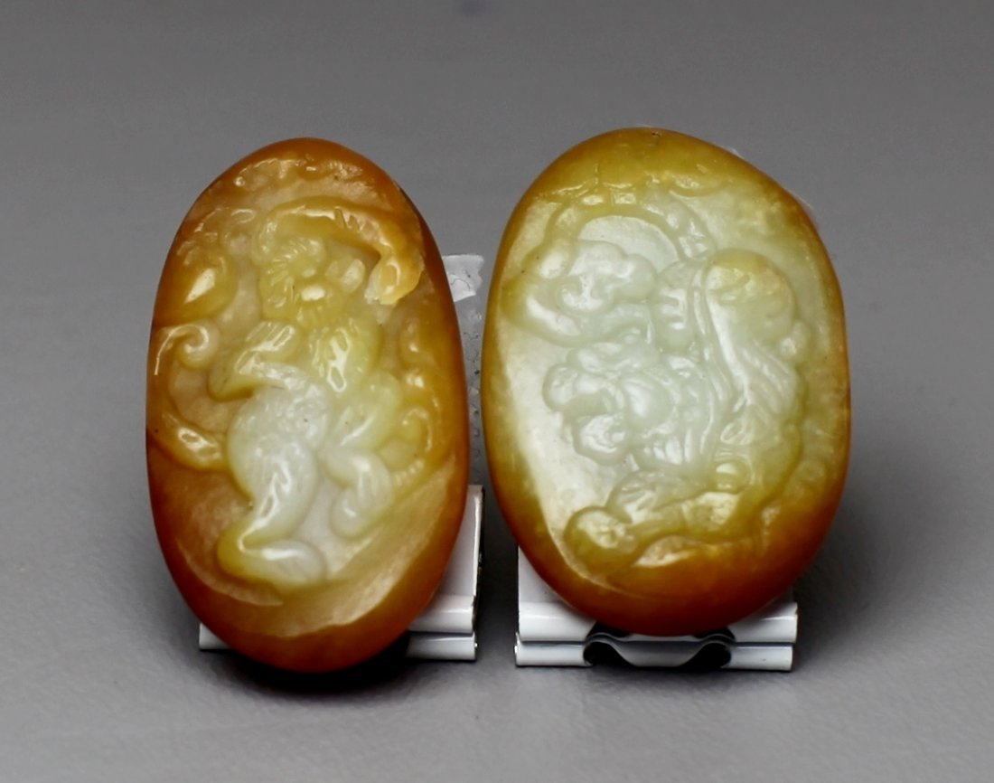 24: TWO CARVED JADE PEBBLES