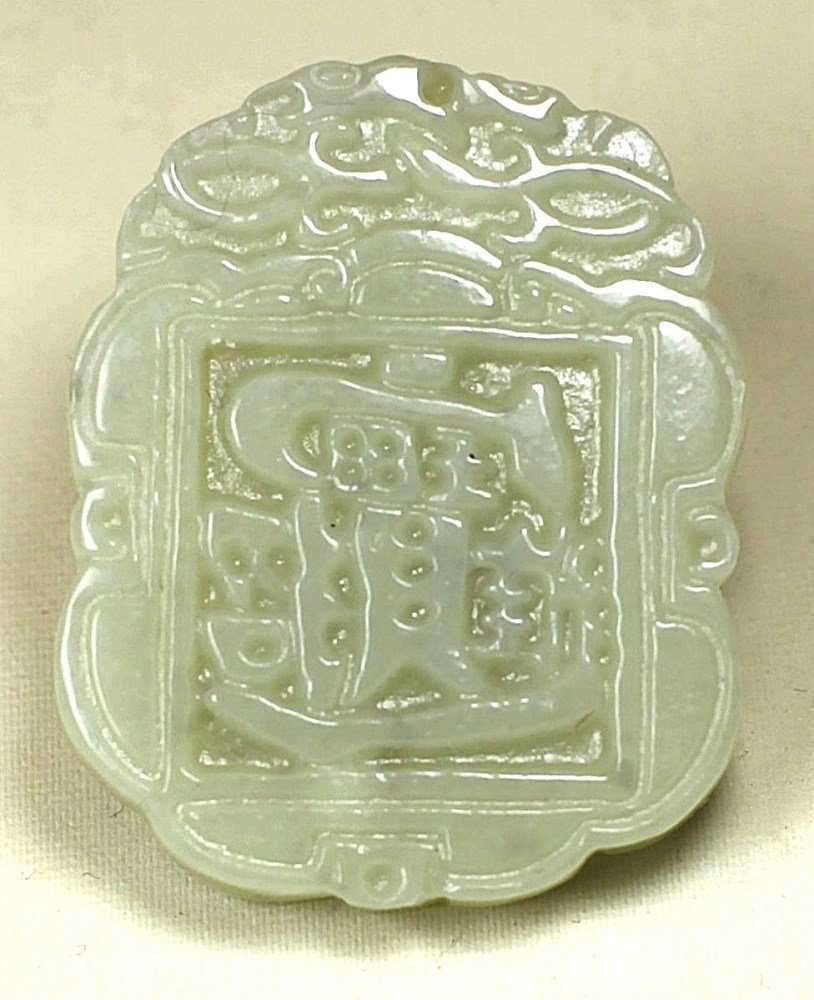 DOUBLE SIDE CARVED WHITE JADE PENDANT