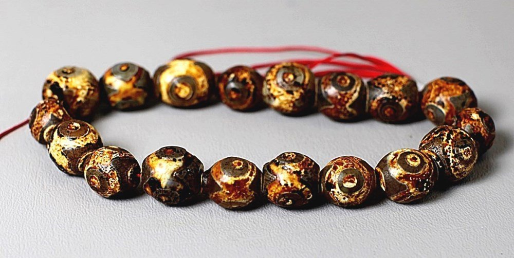 EIGHTEEN TIBET BEADS