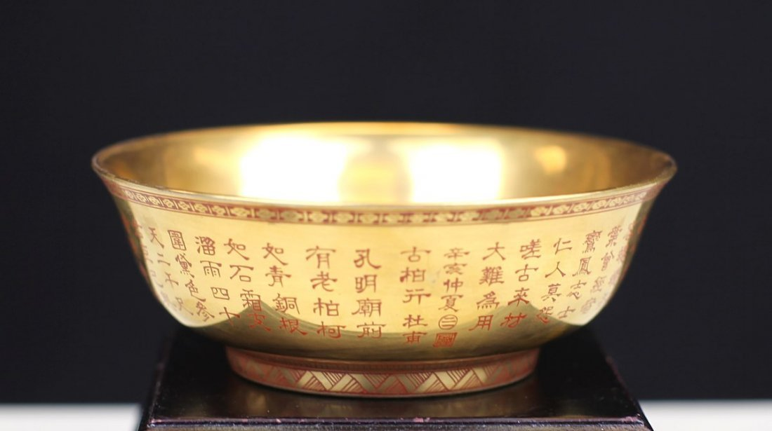 GILT PORCELAIN BOWL WITH MARKS OF HAND-WRITTEN